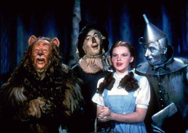 "** FILE ** Bert Lahr (from left) as the Cowardly Lion, Ray Bolger as the Scarecrow, Judy Garland as Dorothy and Jack Haley as the Tin Woodman star in the 1939 film ""The Wizard of Oz."""