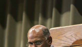 "In this file photo, Republican National Committee Chairman Michael Steele prepares to speak at the ""Bless The Mic"" lecture series at Philander Smith College in Little Rock, Ark., Monday, Sept. 21, 2009. (AP Photo/Danny Johnston)"