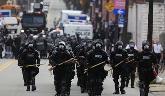 Pittsburgh police in riot gear redeploy Thursday after confrontations with protesters near the Strip District in Pittsburgh. Hundreds of demonstrators marched in protest of the G-20 summit, which is expected to begin in Pittsburgh on Thursday. (Associated Press)