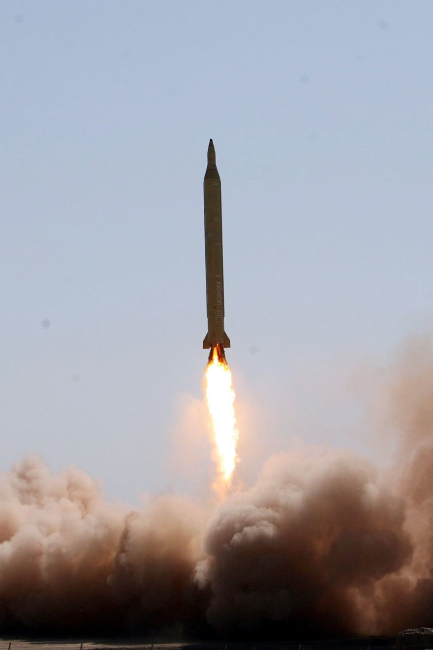** FILE ** This 2009 file photograph, originally released by Iran's semi-official Fars News Agency, purports to show the launch of a Shahab-3 medium-range missile at an undisclosed location in Iran. (Associated Press)