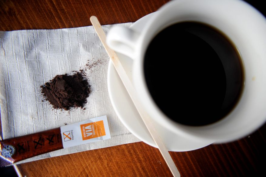 ** FILE ** Starbucks Corp., based in Seattle, hopes its new venture into instant coffee, Via, will be as prevalent in stores as its packaged coffee is now. The Starbucks instant comes in just shy of a $1 a cup, compared with the pennies a cup of home-brewed joe can cost. (Associated Press)