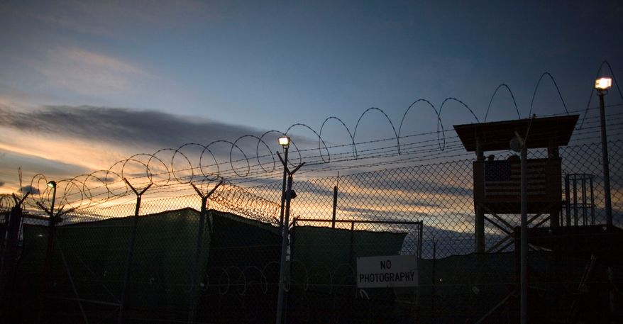 ** FILE ** The closing of the detention facility at the U.S. naval base at Guantanamo Bay, Cuba, was one of President Obama's chief campaign pledges. (AP Photo)