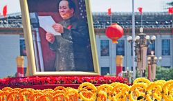 A giant portrait of former Chinese Communist Party leader Mao Zedong is carried during National Day celebrations in Beijing on October 1, 2009 as China celebrated 60 years of communist rule with a military parade and lavish ceremonies showcasing the nation's revival as a global power.  (FREDERIC J. BROWN/AFP/Getty Images)
