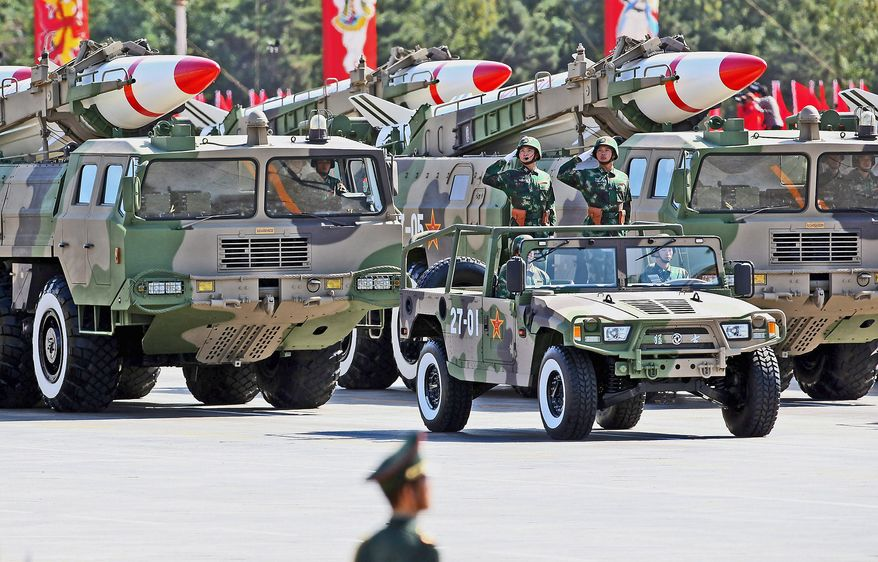 Chinese military missiles are displayed at a massive parade to celebrate the 60th anniversary of the founding of the People's Republic of China on October 1, 2009 in Beijing, China. The grand celebrations to commemorate the 60th anniversary of the founding of the People's Republic of China included a military parade and mass pageant consisting of about 200,000 citizens in Tian'anmen Square. (Photo by Feng Li/Getty Images)