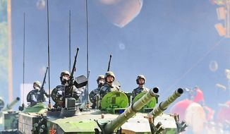 Chinese People's Liberation Army (PLA) tanks rumble pass Tiananmen Square during the National Day parade in Beijing on October 1, 2009. (FREDERIC J. BROWN/AFP/Getty Images)