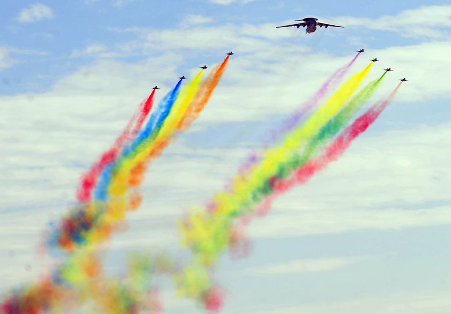 **FILE** Various aircrafts from the Chinese People's Liberation Army airforce perform a fly pass during the National Day parade in Beijing on Oct. 1, 2009. (AFP/Getty Images)
