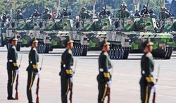 Military equipment is paraded along the Avenue of Eternal Peace (Chang'An Avenue) past Tiananmen Square during National Day celebrations in Beijing on October 1, 2009. China celebrated 60 years of communist rule with a military parade and lavish ceremonies showcasing the nation's revival as a global power. ( FREDERIC J. BROWN/AFP/Getty Images)