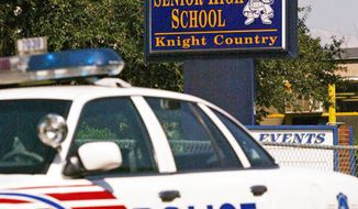 A police car is parked out front of Ballou Senior High School in southeast Washington, DC on the first day of classes on Wednesday, September 1, 2004.  ( Angela Kershner / The Washington Times )
