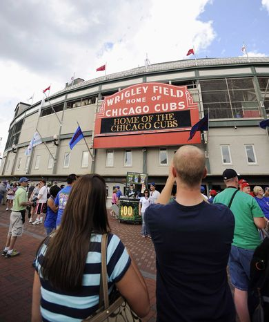 ** FILE ** Fans arrive for a baseball game between the Atlanta Braves and the Chicago Cubs at Wrigley Field in Chicago in 2009. (AP Photo/David Banks)
