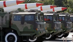 **FILE** Chinese army trucks carrying new long-range and cruise missiles are shown off during China's 60th anniversary celebration in October 2009. (Associated Press)