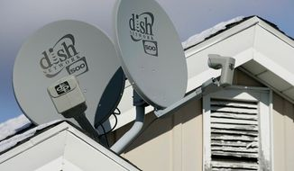 AP **FILE** Dish Network Corp. satellite dishes are attached to a home in Buffalo, N.Y.