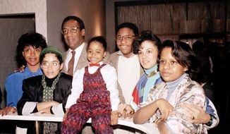 "Bill Cosby poses with cast members of the 1980s sitcom ""The Cosby Show."" (Associated Press)"