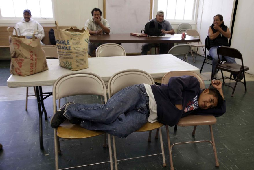 Unemployed worker Jesus Hernandez, who has been unemployed for over a month, waits with other unemployed people at the Day Worker Center of Mountain View, in Mountain View, Calif., on Friday, Oct. 2, 2009. (AP Photo/Paul Sakuma)