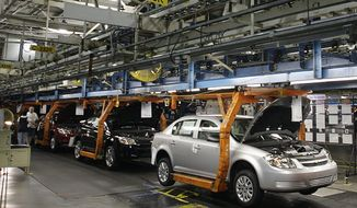 The Chevy Cobalt is on the assembly line at the Lordstown Assembly Plant in Lordstown, Ohio. (Associated Press)