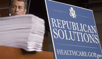 FILE - In this Oct. 29, 2009 file photo House Minority Leader John Boehner of Ohio stands behind a copy of the Democrat's version of the health care bill during a news conference on Capitol Hill in Washington. Boehner, in his Saturday Oct. 31, 2009, radio and Internet address, argues that the Democrats' proposal to overhaul health care is too complicated, too intrusive and too expensive, and Republicans are urging several steps they claim would bring down costs while not greatly expanding government. (AP Photo/Harry Hamburg, File)