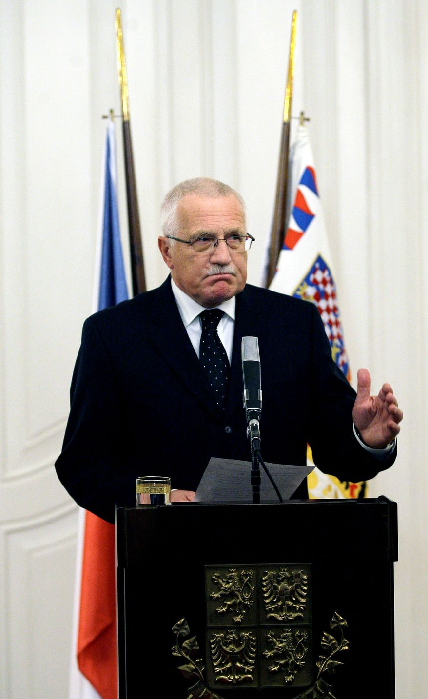 ASSOCIATED PRESS Vaclav Klaus, president of the Czech Republic, signs the Lisbon Treaty on Tuesday, expanding the powers of the European Union. The longtime holdout was the last of the 27 nations in the union to ratify the treaty.