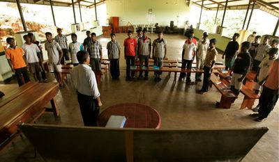 Former child soldiers, who were forced by militant Tamil Tigers to fight government forces, attend a lesson at a rehabilitation center in Sri Lanka. The government wants to ensure that the youths don't pick up arms again, offering classes in plumbing, metalwork, sewing and cooking.