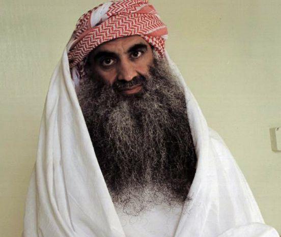 **FILE** This July 2009 photo downloaded from the Arabic language web site www.muslm.net shows a man identified by the site as Khalid Sheik Mohammed, the accused mastermind of the Sept. 11 attacks, in detention at Guantanamo Bay, Cuba. The picture was allegedly taken by the International Committee of the Red Cross (ICRC) and released only to the detainee's family. An Obama administration official said Friday that Mohammed and four other Guantanam