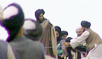 Five-year-old footage of Mullah Mohammed Omar (center) rallying his Taliban troops in Kandahar, Afghanistan, was found in the BBC's vaults and aired in 2009. (Associated Press/BBC TV) ** FILE **