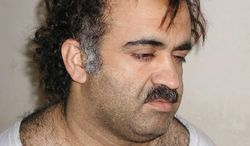 **FILE** Khalid Sheikh Mohammed, the alleged Sept. 11 mastermind, is seen shortly after his capture during a raid in Pakistan in March 2003. (Associated Press)