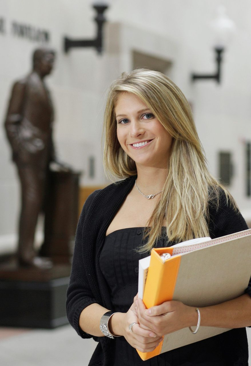 Liz Weaver of Nashville, Tenn., is a second-year law student at the University of Texas in Austin, where she is trying to decide whether to enroll in a program in London next fall that would saddle her with even more college debt. (Associated Press)