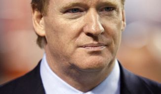 In this Nov. 9, 2009, file photo, NFL commissioner Roger Goodell looks on during an NFL football game between the Pittsburgh Steelers and the Denver Broncos at Invesco Field at Mile High in Denver. (AP Photo/Jack Dempsey, File)