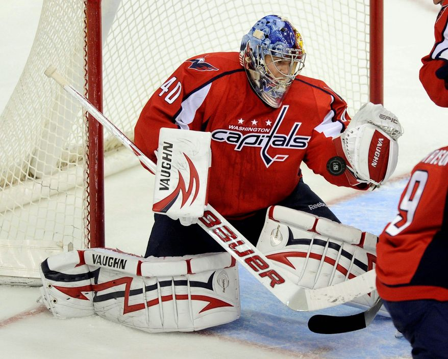 Washington Capitals traded goalie Semyon Varlamov to the Colorado Avalanche for a first-round pick in 2012 and a second-round pick in either 2012 or 2013. (Associated Press)