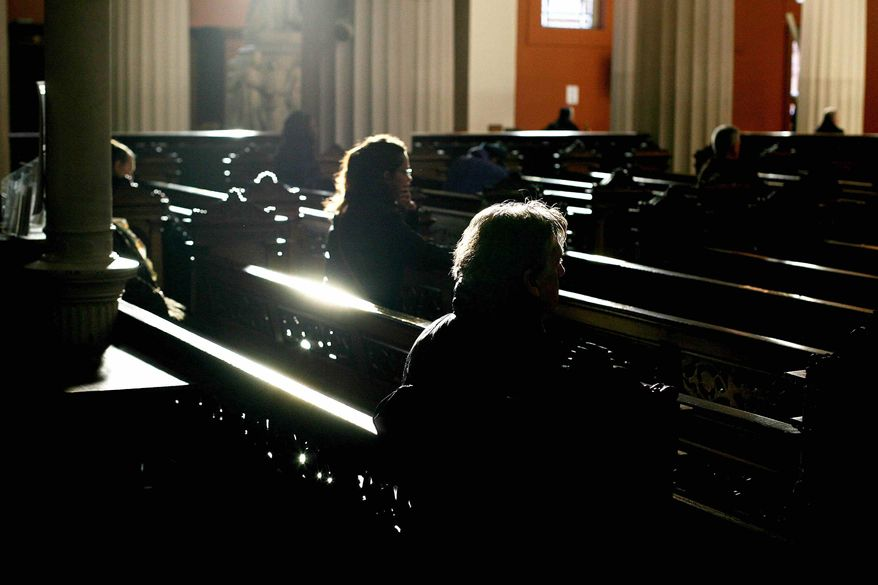 Visitors attend Mass at St. Mary's Pro-Cathedral in Dublin, Ireland. (AP File Photo/Niall Carson-pa)