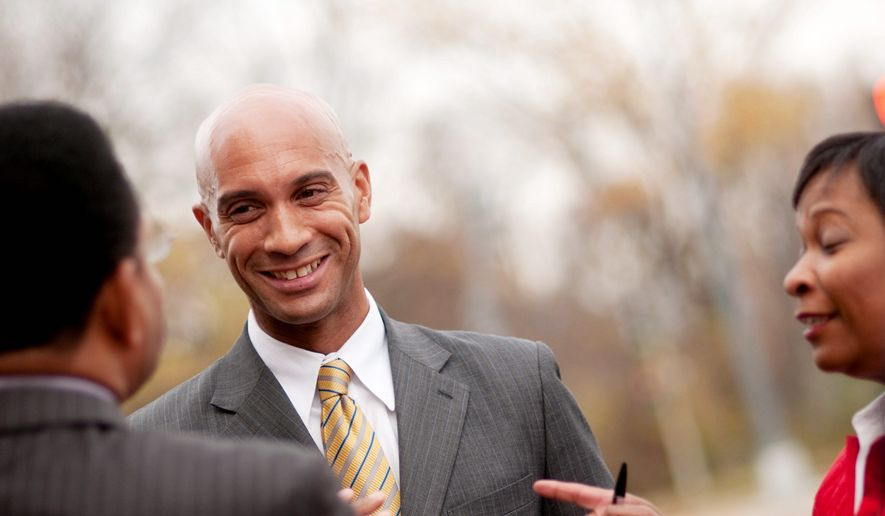 ABOVE Mayor Adrian Fenty speaks to reporters at the intersection of Eastern and Kenilworth Aves. in NE Washington D.C., after a press conference to announce the replacement of Eastern Ave. bridge, Tuesday, November 10, 2009. (Allison Shelley/ The Washington Times)