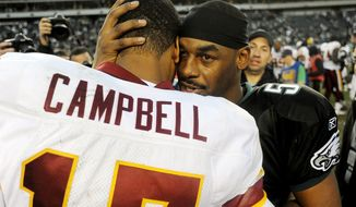 Redskins Jason Campbell (17) talks with Eagles Donovan McNabb (5) after a 27-24 Redskins loss at Lincoln Financial Field in Philadelphia, Pa., Sunday, November 29, 2009. (Peter Lockley / The Washington Times)