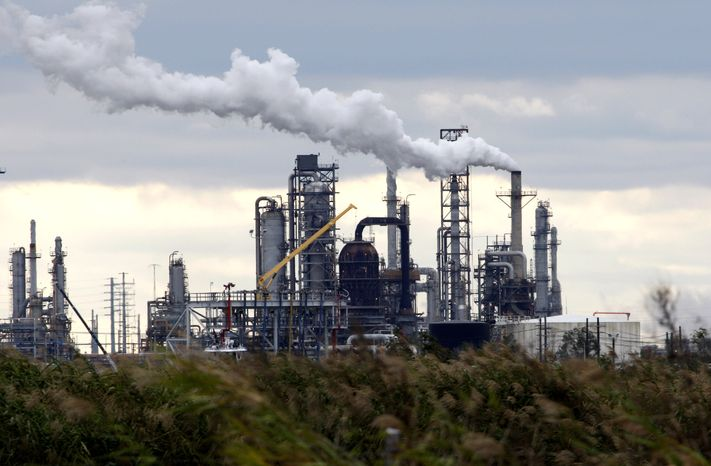 ** FILE ** The Total Port Arthur refinery is shown Wednesday, Dec. 2, 2009, in Port Arthur, Texas. Over the past several years, Total Petrochemical's sprawling oil refinery in southeast Texas has sprayed tons of sulfuric acid and carbon monoxide into the sky. The French company's 62-year-old facility has also released cancer-causing benzene, regularly surpassed allowable pollution limits, failed to report dozens of emissions and how much. Total is the most heavily fined polluter in Texas in the 2009 fiscal year, according to the year-end report summarizing how companies were punished in the state that produces the most industrial pollution. (AP Photo/David J. Phillip)