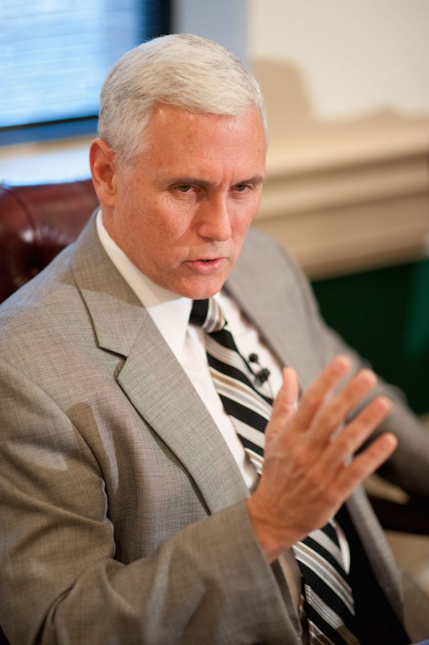 ** FILE ** Rep. Mike Pence, Indiana Republican, stresses the importance of state fiscal responsibility. (Michael Connor/The Washington Times)
