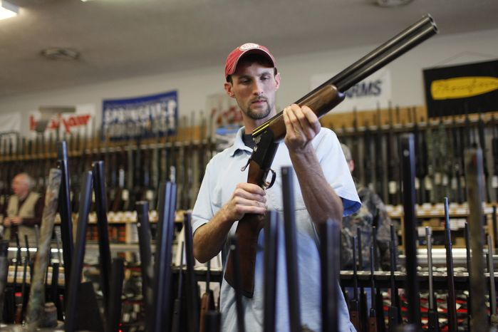 Adam Henderson shops Friday for a rifle at Guns and Leather, a firearms store and shooting range, in Greenbrier, Tenn. A nationwide review by Associated Press found that over the last two years, 24 states, mostly in the South and West, have passed 47 new laws loosening gun restrictions. (Associated Press)