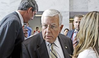 ** FILE ** Sen. Michael B. Enzi, Wyoming Republican. (Associated Press)