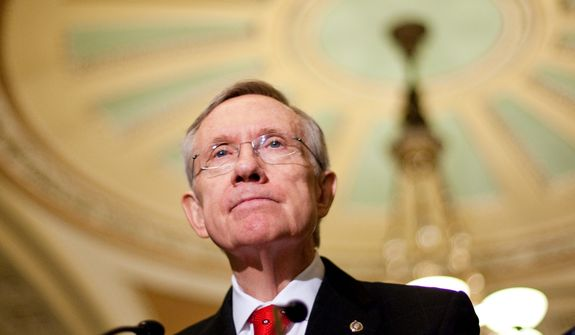 Senate Majority Leader Harry Reid, Nevada Democrat, was forced to keep all 60 members of his caucus in Washington over a December 2009 weekend to overcome a Republican filibuster. (AP Photo)