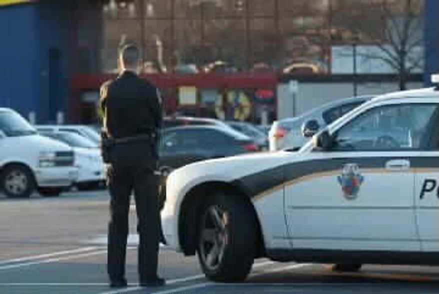 ** FILE ** A police officer patrols a parking lot in Montgomery County. (Photo provided by the Montgomery County Police Department)