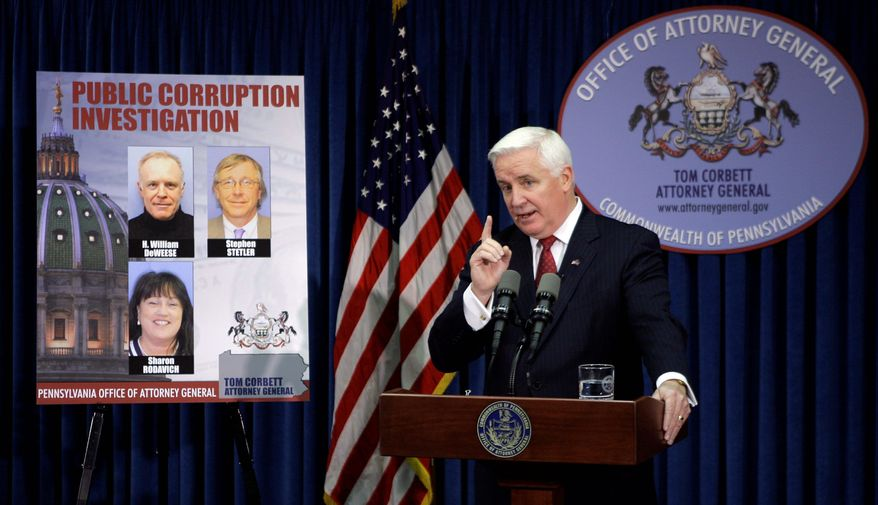 Pennsylvania Attorney General Tom Corbett on Tuesday in Harrisburg, Pa., names more defendants in the state's expanding investigation of legislative corruption. (Associated Press)