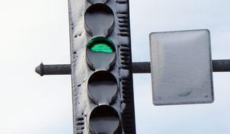 associated press Snow-covered traffic lights caused a fatal accident during a snowstorm in Oswego, Ill., in April. The problem stemmed from replacing incandescent lights with energy-efficient ones, which aren't hot enough to melt the snow.