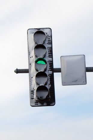 associated press Snow-covered traffic lights caused a fatal accident during a snowstorm in Oswego, Ill., in April. The problem stemmed from replacing incandescent light