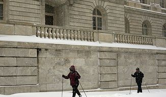 Cross country skiers pass by the Cannon House Office building on Capitol Hill during a snow storm in Washington, DC, on December 19, 2009. Congress this month is beginning a 10-year, $752.7 million renovation project on the building that will include replacing all of the pipes and plumbing, some of which are more than 100 years old. (Katie Falkenberg / The Washington Times)