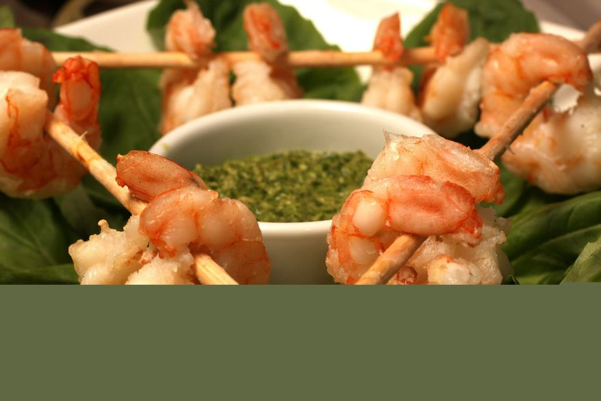 ** FILE ** This Dec. 12, 2009, file photo shows grilled shrimp with Thai-style pesto for dipping. (Associated Press)