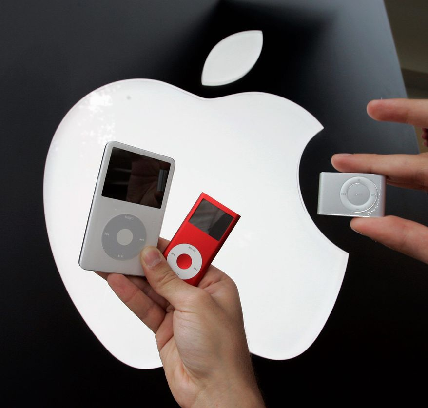 Apple's 60GB iPod (left) is shown next to an iPod Nano (center) and then-new iPod Shuffle at an Apple store in November 2006.