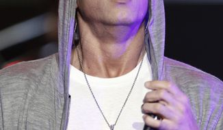 "** FILE ** Rapper Eminem performs at a concert celebrating the launch of the video game ""DJ Hero"" in Los Angeles on in this June 1, 2009, file photo. Elton John said Saturday, Jan. 2, 2010, that he has been helping American rapper Eminen fight drug problems for more than a year. (AP Photo/Matt Sayles, File)"