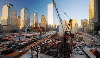A steel frame is rising at Ground Zero (center) in New York City for a $3.2 billion tower known as 1 World Trade Center. The Port Authority needs a partner to market the office space. (Associated Press) ** FILE **