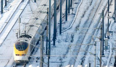 ASSOCIATED PRESS A Eurostar high-speed train is pulled from the Channel Tunnel in England on Thursday after breaking down earlier in the morning. Passengers were transferred to another train.