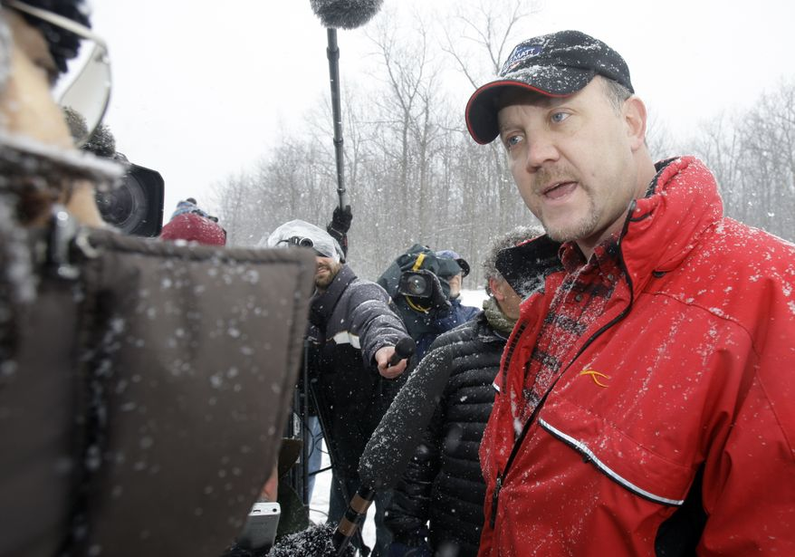 ** FILE ** Bradley Birkenfeld, a whistle-blower in the tax evasion case against Swiss bank UBS AG, holds a news conference outside the Schuylkill County Federal Correctional Institution in Minersville, Pa., Friday, Jan. 8, 2010, before reporting to the federal prison. (AP Photo/Carolyn Kaster)