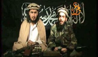 In this image taken from undated video made available from Taliban sources on Saturday Jan. 9, 2010, purportedly showing Humam Khalil Abu Mulal al-Balawi, right, reading a statement to camera vowing revenge for the death of Pakistani Taliban chief Baitullah Mehsud, while sitting next to the new leader of the Pakistani Taliban, Hakimullah Mehsud. The authenticity of this video is unconfirmed. (AP Photo/Taliban video via APTN)