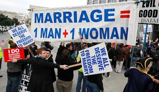 Demonstrators for and against same-sex marriage protest during a rally in front of a federal courthouse in San Francisco, Monday, Jan. 11, 2010. The first federal trial to determine if the U.S. Constitution prohibits states from outlawing same-sex marriage gets under way in San Francisco on Monday, and the two gay couples on whose behalf the case was brought will be among the first witnesses. (AP Photo/Paul Sakuma)