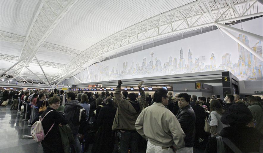 Passengers wait to be re-screened due to a security breach at Terminal 8 of JFK airport in New York on Jan. 16, 2010. (Associated Press) **FILE**