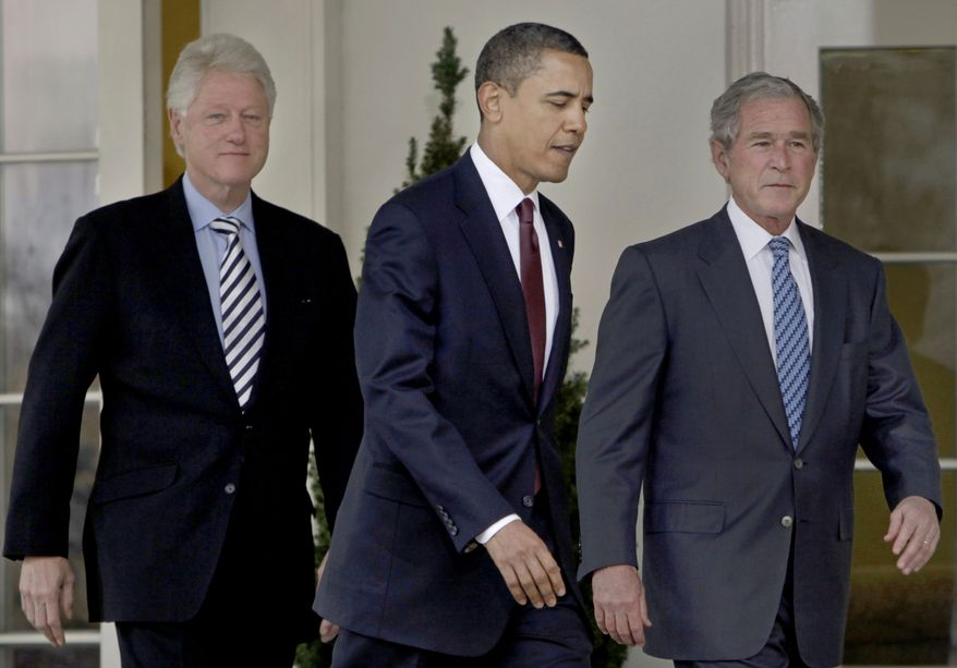 President Obama (center) walks out of the Oval Office of the White House with former Presidents Bill Clinton (left) and George W. Bush to deliver remarks in the Rose Garden in Washington on Saturday, Jan. 16, 2010. Mr. Obama asked the former presidents to help with U.S. relief efforts in Haiti after the earthquake. (AP Photo/Pablo Martinez Monsivais)